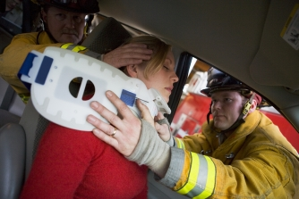 Rescuers rescuing a women from an accident